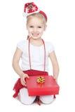 礼品女孩帽子一点红色圣诞老人白色 免版税库存图片