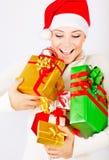 礼品女孩愉快的暂挂的圣诞老人 免版税库存图片