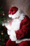 礼品魔术圣诞老人 库存图片