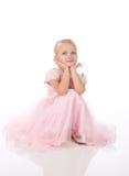 礼服典雅的女孩一点粉红色 免版税库存图片