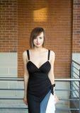 礼服典雅的花梢华美的妇女 免版税库存图片