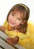 礼服女孩一点微笑的黄色 库存图片
