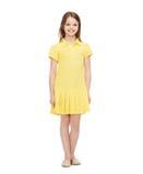 礼服女孩一点微笑的黄色 免版税库存图片