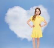 礼服女孩一点微笑的黄色 库存照片