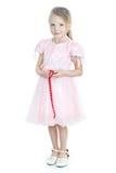 礼服女孩一点粉红色身分 免版税库存图片