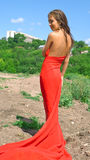 礼服女孩红色微笑 图库摄影