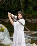 礼服女孩递了剑二个空白年轻人 免版税库存图片