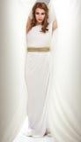 礼服希腊被启发的微笑的白人妇女年&# 免版税库存图片