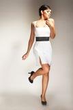礼服时装模特儿摆在了白色 免版税库存照片