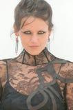 礼服有花边的性感的妇女 免版税库存图片