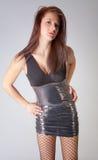 礼服渔网裤袜性感的严密的妇女 免版税库存照片