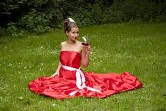 礼服玻璃红色妇女 免版税库存照片