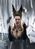 礼服的一个新和恼怒的女性吸血鬼 库存照片