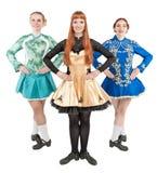 礼服的三名美丽的妇女爱尔兰语的跳舞隔绝 免版税图库摄影