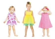 礼服的女婴,孩子小组,小孩孩子 免版税库存图片