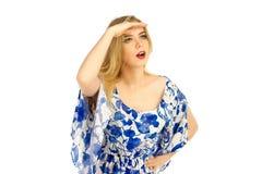 礼服的女孩有花纹花样摆在的 免版税库存图片