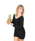 黑礼服的妇女用菠萝 图库摄影