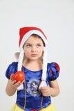 礼服的小女孩雪白用蕃茄 免版税图库摄影