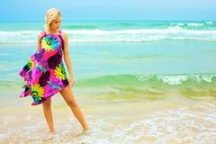 礼服的少妇在海滩 免版税图库摄影