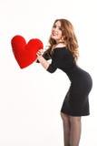 黑礼服的美丽的女孩有红色的在白色背景听见 免版税库存照片