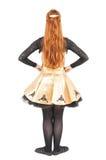 礼服的美丽的妇女爱尔兰语的跳舞隔绝 后面姿势 免版税库存照片