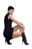 礼服短的惊人的妇女年轻人 免版税库存图片