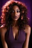 礼服紫色平直的妇女 库存图片
