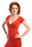 礼服红色微笑的妇女年轻人 免版税图库摄影