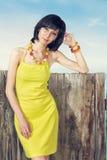 礼服纵向妇女黄色 免版税库存照片
