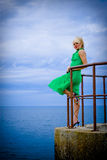 礼服绿色妇女 免版税库存照片