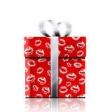 礼物和亲吻 免版税库存图片