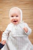 洗礼衣裳的愉快的婴孩 免版税库存图片