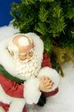 祈祷的圣诞老人 库存照片