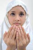 祈祷的妇女年轻人 免版税库存照片