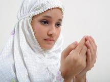 祈祷的妇女年轻人 免版税图库摄影