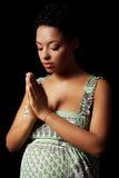 祈祷的孕妇年轻人 免版税图库摄影