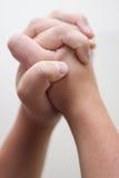 祈祷的手 库存照片
