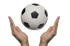 祈祷的足球 免版税库存图片