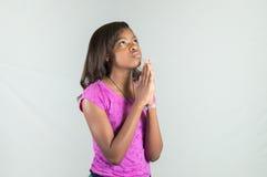 祈祷的非裔美国人青少年 免版税图库摄影