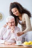 祖父和成人孙女 免版税库存照片