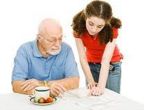 祖父帮助 免版税库存图片