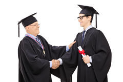 祝贺一名年轻学生的教务长 免版税库存图片