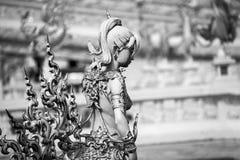 神话母鸟雕象与一个人头的 免版税库存图片
