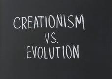 神造论对演变 免版税库存图片
