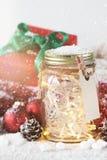 神仙的圣诞节假日在有圣诞节decoratio的一个瓶子点燃 免版税库存图片