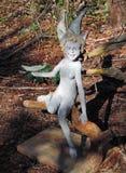 神仙的雕塑在秋天庭院里 库存图片