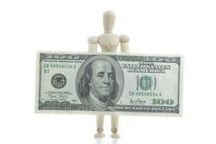 票据美元拿着人体模型 库存图片