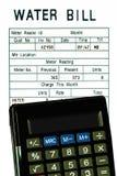 票据计算器概念查出的水 免版税库存图片