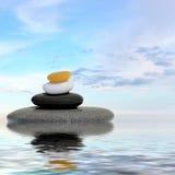 禅宗在水反映的按摩石头 库存照片