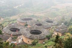 福建,中国- 2016年1月03日:Tianlo的南靖田螺坑土楼群 库存图片